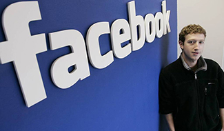 Facebook founder and CEO Mark Zuckerberg poses at Facebook headquarters in Palo Alto, Calif., Feb. 5, 2007. In an about-face following a torrent of online protests, Facebook is backing off a change in its user policies while it figures how best to resolve questions like who controls the information shared on the social networking site. (AP Photo/Paul Sakuma)