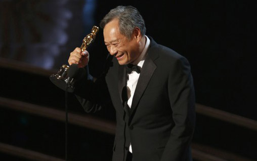 """Director Ang Lee reacts after winning the Oscar for best director for """"Life of Pi"""" at the 85th Academy Awards in Hollywood"""
