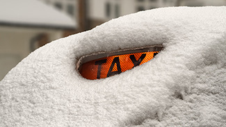 сайтLondon-TAXI-under-the-snow